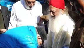 Asaram's foot touches outside
