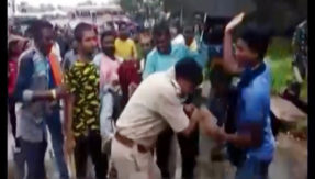 PM Narendra Modi rally Midnapore Policeman assaulted by BJP workers