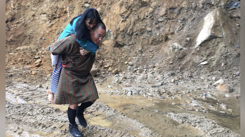 Bhutan former PM Tshering Tobgay carried his wife Tashi Doma on his back to prevent her feet from dust