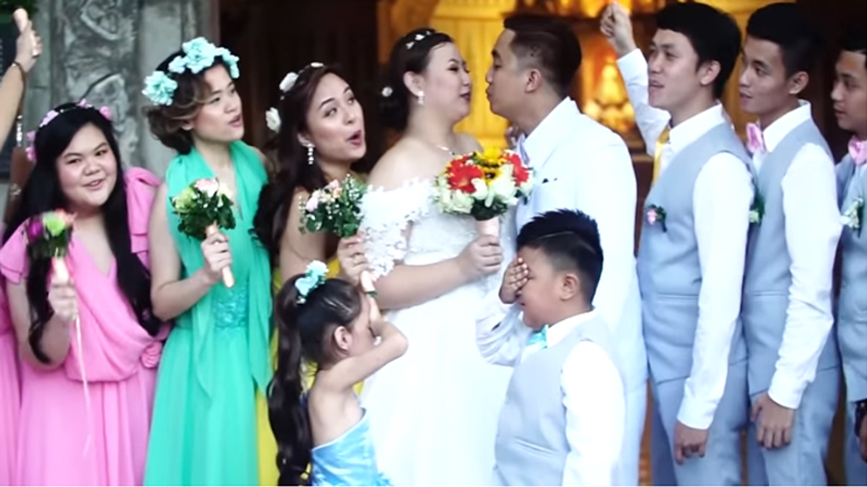Photographer asks newlyweds to kiss page boy kisses little flower girl